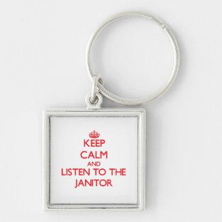 Guarde la calma y escuche el portero llavero cuadrado plateado