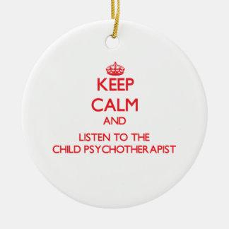 Guarde la calma y escuche el psicoterapeuta del adornos de navidad