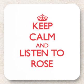 Guarde la calma y escuche el rosa posavasos de bebidas