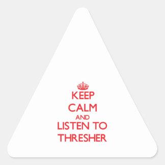 Guarde la calma y escuche la TRILLADORA