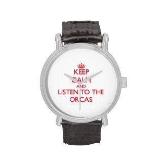 Guarde la calma y escuche las orcas relojes