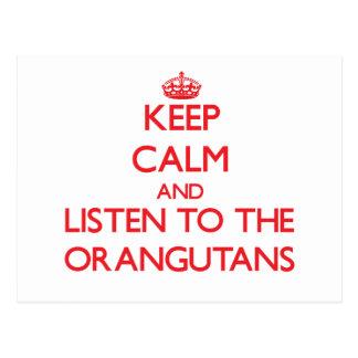 Guarde la calma y escuche los orangutanes tarjetas postales