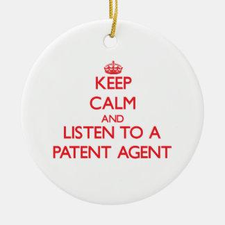 Guarde la calma y escuche un agente de patente adorno para reyes