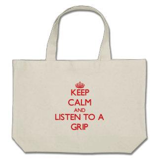 Guarde la calma y escuche un apretón bolsa lienzo