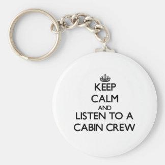 Guarde la calma y escuche un equipo de la cabina llavero redondo tipo pin