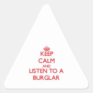 Guarde la calma y escuche un ladrón pegatina triangular