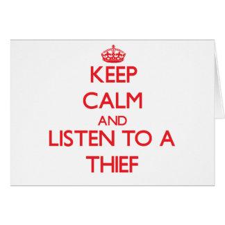 Guarde la calma y escuche un ladrón tarjetón