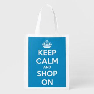 Guarde la calma y haga compras en azul y el blanco bolsa de la compra