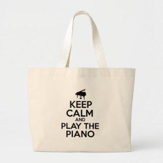 Guarde la calma y juegue el piano bolsa tela grande