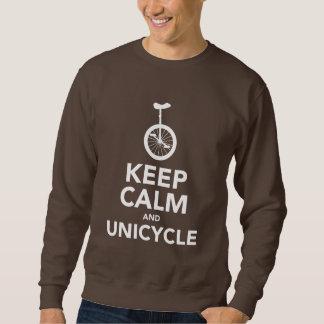 Guarde la calma y la camiseta del Unicycle