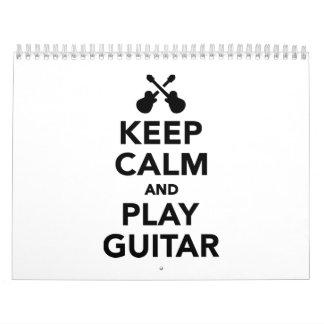 Guarde la calma y la guitarra del juego calendario