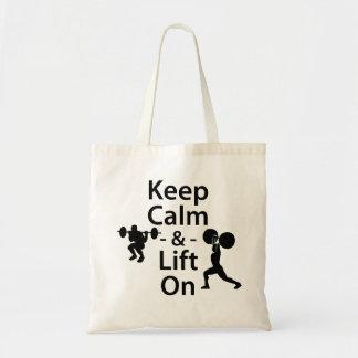 Guarde la calma y levante encendido bolsas de mano