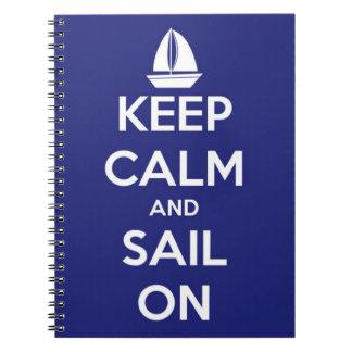 Guarde la calma y navegue en azul libretas