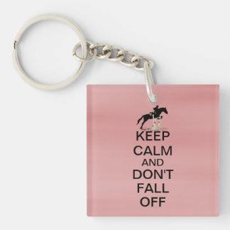 Guarde la calma y no se caiga de caballo llavero