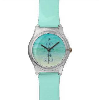 Guarde la calma y piense en el reloj de la playa