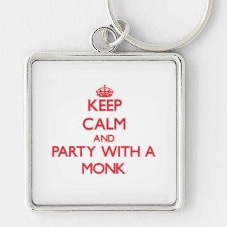 Guarde la calma y vaya de fiesta con un monje llaveros