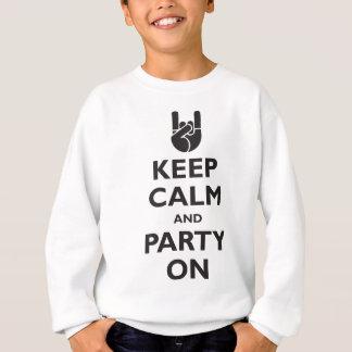 Guarde la calma y vaya de fiesta encendido remeras