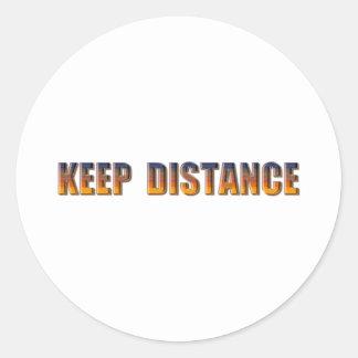 Guarde la distancia pegatina redonda