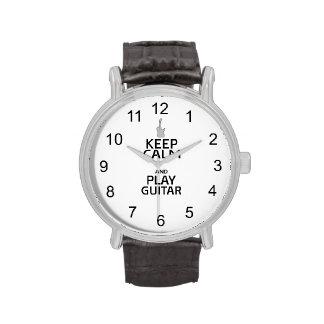 Guarde la guitarra eléctrica de la calma y del reloj de mano