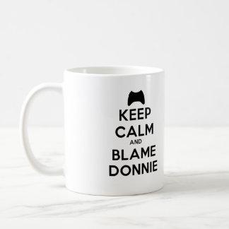 Guarde la taza de Donnie de la calma y de la culpa