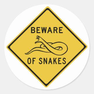 Guárdese de las serpientes, señal de peligro del pegatina redonda