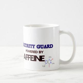Guardia de seguridad accionado por el cafeína taza de café