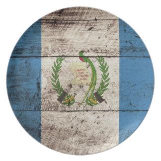 Guatemala Flag on Old Wood Grain Dinner Plate