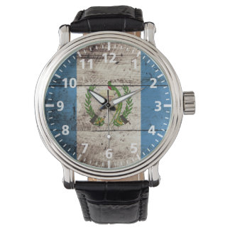 Guatemala Flag on Old Wood Grain Wrist Watch