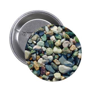 Guijarros coloridos de las piedras pin