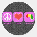 Guinea del amor de la paz pegatina redonda