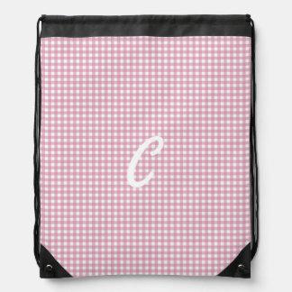 Guinga en rosa mochila