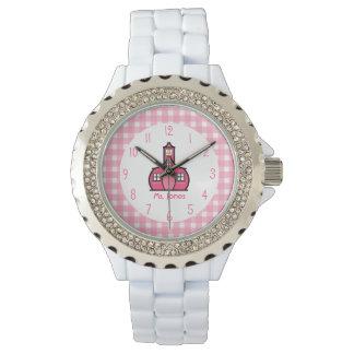 Guinga y reloj rosado del profesor de la escuela