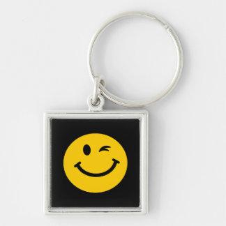 Guiño de la cara sonriente llaveros personalizados