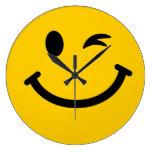 Guiño de la cara sonriente relojes