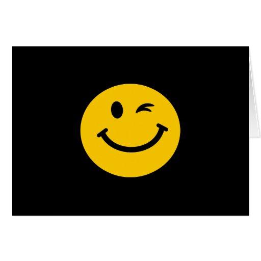 Guiño de la cara sonriente tarjeta de felicitación