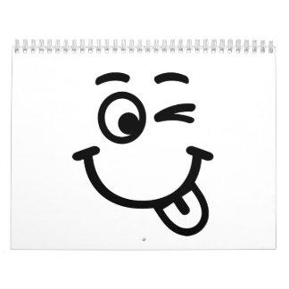 Guiño sonriente de la cara calendarios