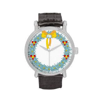 Guirnalda azul de Navidad con el arco y las campan Relojes