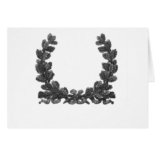 Guirnalda blanco y negro con una cinta tarjeta de felicitación