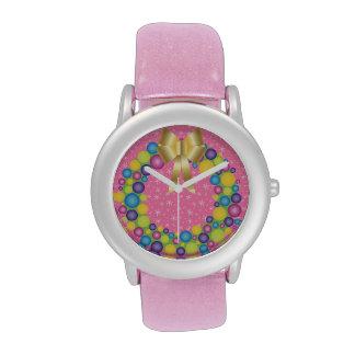 Guirnalda bonita del navidad en rosa relojes de mano
