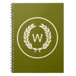Guirnalda de la hoja del laurel del monograma cuadernos