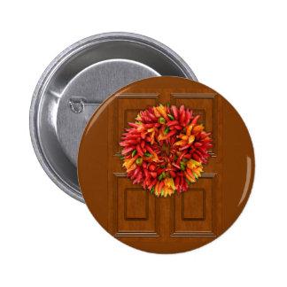 Guirnalda del chile en la puerta de madera pin