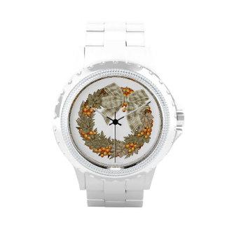 Guirnalda del navidad con las chucherías del oro relojes de mano
