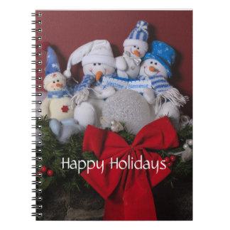 Guirnalda del navidad de la familia del muñeco de  libreta espiral