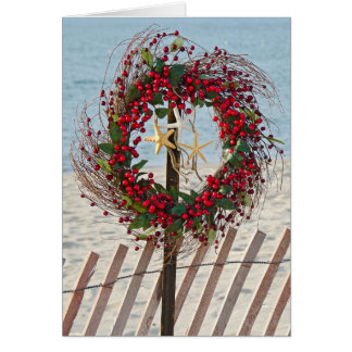 Guirnalda del navidad de la playa tarjeta de felicitación