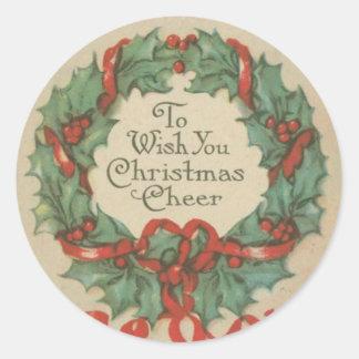 Guirnalda del navidad del vintage con deseos pegatina redonda