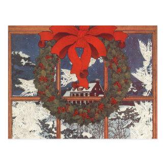 Guirnalda del navidad del vintage en una ventana postal