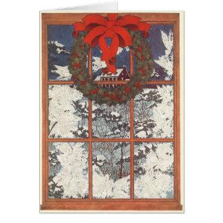 Guirnalda del navidad del vintage en una ventana tarjeta de felicitación