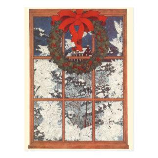 Guirnalda del navidad del vintage en una ventana tarjetas postales