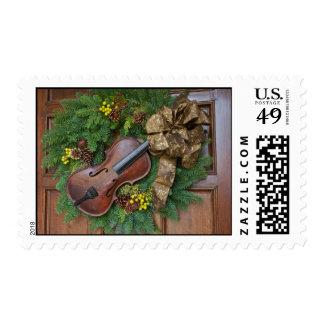 Guirnalda del navidad del violín sellos