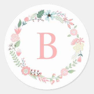Guirnalda floral con monograma pegatina redonda